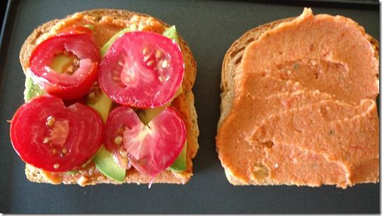 Tomato-avocado-hummus panini on grill